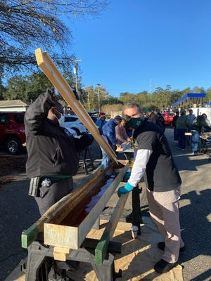 Volunteers from the Leon County Sheriff's Office build bunk beds on Saturday, Dec. 5, 2020, for the Sleep in Heavenly Peace, a national nonprofit with 200 chapters. They built 15 beds for area children in need at Precision Dent Removal, a partner in the effort.