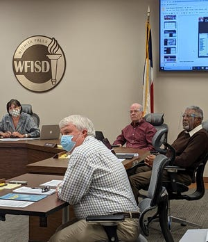 Wichita Falls ISD trustees listen to a presentation during a school board meeting Tuesday, Dec. 8, 2020.