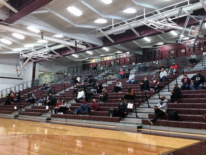 Basketball crowds during COVID-19, like this one during the Zanesville boys basketball game at Newark's Jimmy Allen Gymnasium on Dec. 8, 2020, have been limited to only parents and necessary personnel.