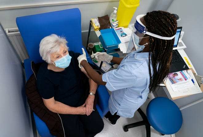 A nurse prepares to administer the Pfizer-BioNTech COVID-19 vaccine to patient Anne Irene at Croydon University Hospital, at the start of the largest ever immunization program in the UK's history on December 8, 2020 in London, United Kingdom. The vaccines by Pfizer and Moderna will soon start distribution in the U.S., including in North Carolina.