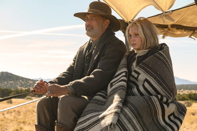 "Tom Hanks plays a Civil War veteran taking a 10-year-old girl (Helena Zengel) back home in ""News of the World."""
