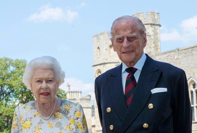 Queen Elizabeth II and Prince Philip the Duke of Edinburgh pose for a photo June 1, 2020, in the quadrangle of Windsor Castle.