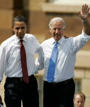 Then-Democratic presidential candidate Barack Obama, D-Ill., and his choice for a running mate, Joe Biden, appear together outside the Old State Capitol on Aug. 23, 2008, in Springfield, Ill.