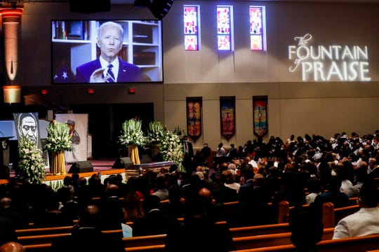 Joe Biden gives a videotaped message during the funeral for George Floyd on June 9 at the Fountain of Praise church in Houston. Floyd died after being pinned by a Minneapolis police officer May 25.