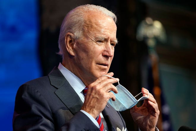 President-elect Joe Biden puts on his face mask after speaking about jobs at The Queen theater, Friday, Dec. 4, 2020, in Wilmington, Delaware.