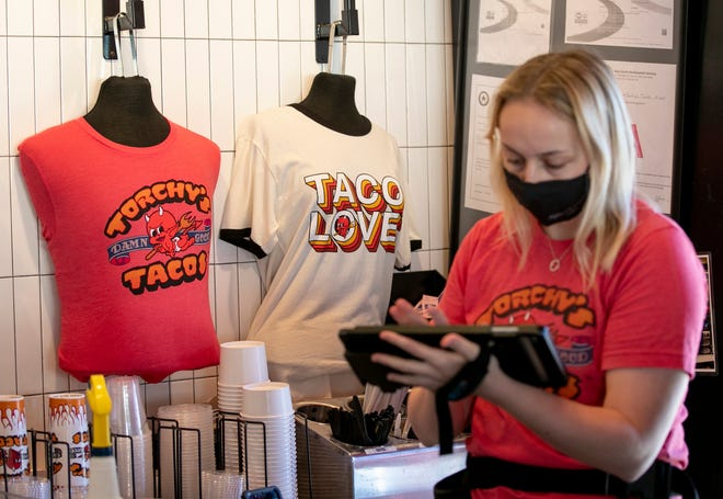 Cashier Olivia Hanna takes an order at Torchy's Tacos at Belterra Village shopping center in Austin on Dec. 3. Austin-based Torchy's is planning to open 100 new locations in the next four years.
