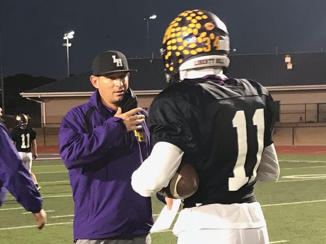 Interim Liberty Hill coach Kent Walker speaks to linebacker Bryce Rampey during a Panther practice on Tuesday. The Panthers are preparing for their bidistrict playoff game Friday against Glenn.