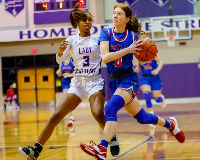Westlake guard Peyton Freiermuth drives to the hoop as San Marcos guard Kayla Presley challenges during the Chaps' win last week. Freiermuth had 20 points,four rebounds, four assists and two steals in the victory.