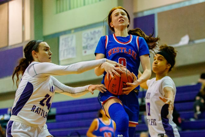 Westlake Chaparrals guard Peyton Freiermuth drives to the basket against San Marcos Rattlers forward Faith Phillips in Westlake's 51-43 Dec. 8 at San Marcos High School.