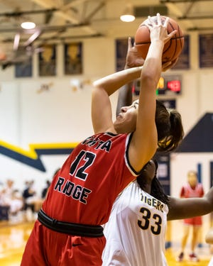 Natalia Islas takes a shot for Vista Ridge against Cedar Ridge in December. Islas had 18 points and 19 rebounds in two wins last week to earn American-Statesman player of the week honors.