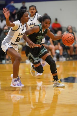 Connally's Mahogany Wright drives to the basket defended by Hendrickson's Makayla Ward in Hendrickson's 58-39 win Dec. 8 at Connally High School. [LOURDES M SHOAF for Statesman]
