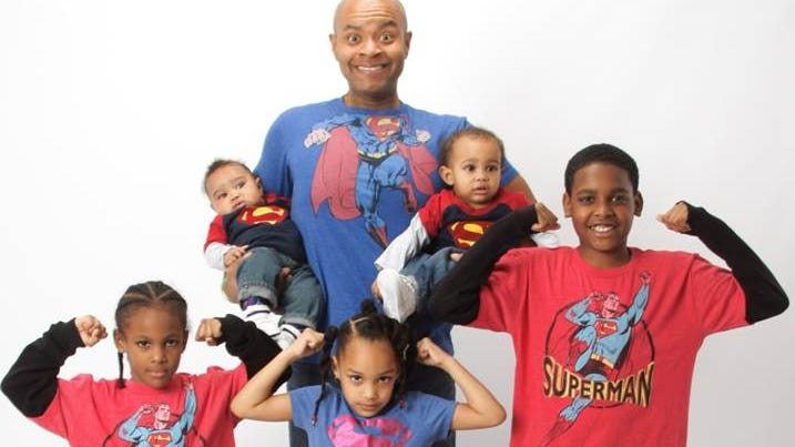 Lemuel Bradshaw, with six of his grandchildren, knows the real superheroes are the donors' families who have given him one heart as a 30-year-old and one as a 50-year-old.