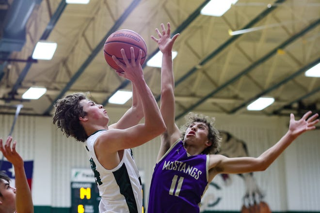 Sam Barnwell goes to the basket and draws the foul for Connally during in Marble Falls' 48-37 win over host Connally on Dec. 8.