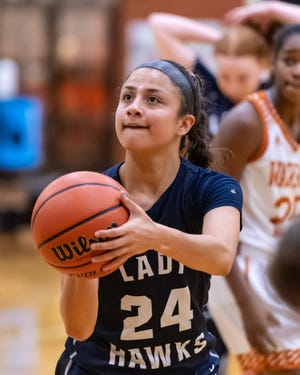Hendrickson senior Erika Suarez, shooting a free throw last season against Westwood, remembers exchanging Christmas gifts on a bus ride to College Station during her freshman year.