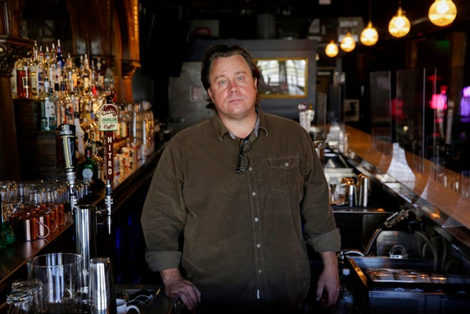 Ryan Garrett poses inside the Green Jay music venue in Austin on Wednesday. Garrett is an operating partner for the Green Jay and is also general manager of Stubbs.