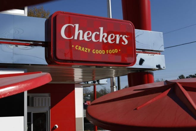 A new Checkers sign was installed as a renovation takes place at the restaurant on Broad Street. [Photo/Joshua Jones/Athens Banner-Herald