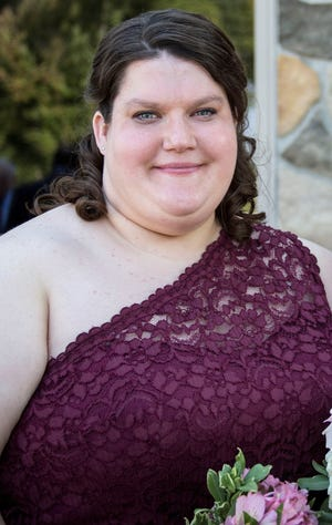 """Jamie Malinowski, 34, died Nov. 8 of COVID-19. She is pictured here at her brother's wedding in 2016. """"She kept commenting that day, that's the most beautiful dress she's ever had,"""" Frank """"Keith"""" Malinowski said."""