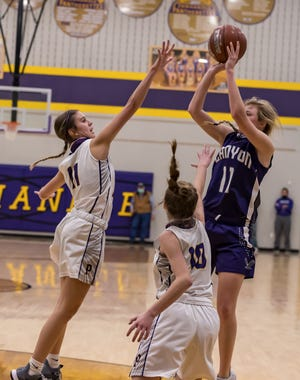 Two Panhandle defenders attempt to prevent a Canyon player from scoring during Tuesday evening's girls' basketball contest between Canyon and Panhandle.