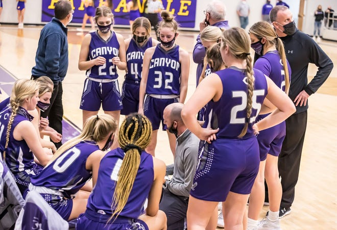 The Canyon Girls' Basketball team meets during a time out during Tuesday evening's contest against Panhandle.