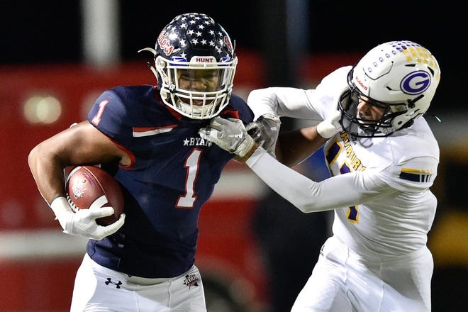 Denton Ryan's Ja'Tavion Sanders, left, has been a high school standout as both a wide receiver and a defensive end. The five-star athlete who's committed to Texas has played more offense than defense his senior season.