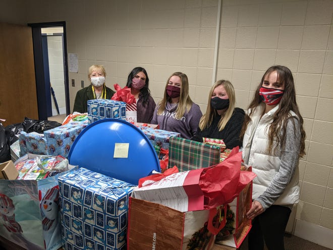 United Local Schools' Community Outreach staffer Betty Whiteleather, from left, and students Hannah Minor, Kassidy Everhart, Hannah Baker and Morgan Briceland work on products being collected for the district's Community Outreach program.