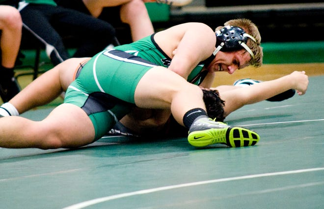 West Branch's Kenny Marra, top, is a three-time state qualifier for the Warriors and has broken the school's career record for wins.