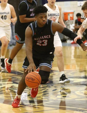 Alliance's Brandon Alexander with the ball during action at Louisville High School on Tuesday, December 8, 2020.