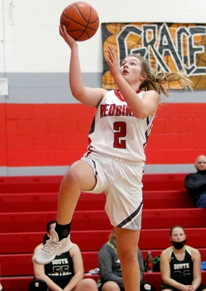 Loudonville's Corri Vermilya (2) drives in for layup during the Redbirds' 83-29 win over South Central.