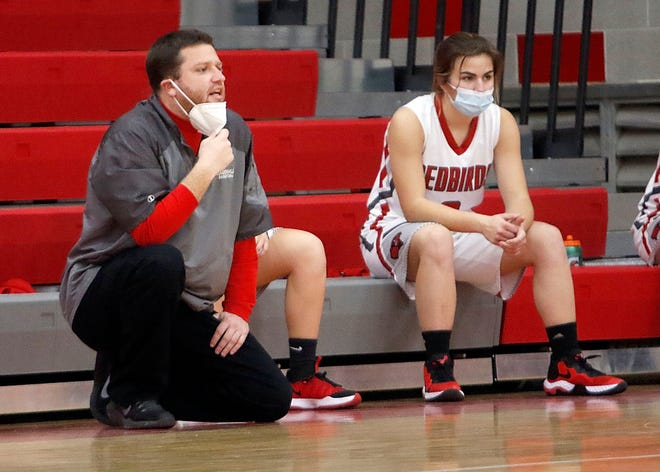 Loudonville High School girls basketball coach Tyler Bates gives instructions to his team from the bench during a game against South Central on Dec. 8, 2020.