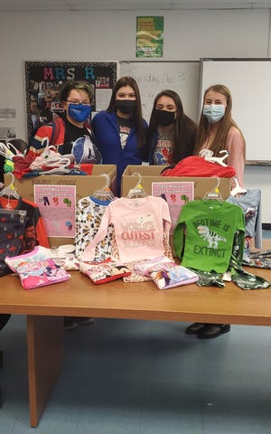 Mapleton High School students and National Honor Society members, from left to right, are Mariah White, Bailey Davis, Sara Hickey and Jasmine Donley. The NHS collected pajamas for Ashland County Job and Family Services.