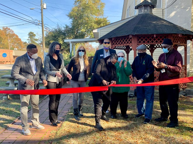 Georgia Mental Health Consumer Network coordinator Roslind Hayes cuts the ribbon Wednesday to what will be the new Peer Recovery and Wellness Center in Augusta.