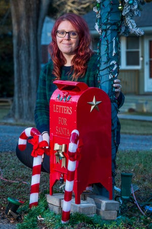 """Kasey Belanger poses with the """"Letters For Santa"""" mailbox in front of her house in North Augusta Tuesday afternoon December 8, 2020. [MICHAEL HOLAHAN/THE AUGUSTA CHRONICLE]"""
