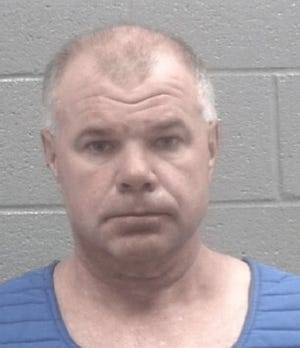 John Sharkey was arrested, charged and fired after he allegedly violated a protective order.