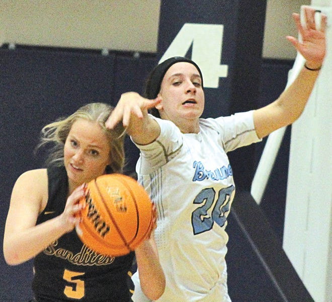 Bartlesville High School guard Elise Rovenstine, right, pressures a Sand Springs player during Tuesday's home opener