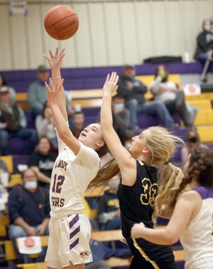 Pilot Grove freshman Emma Sleeper (12) drives in for a layup in the first half Monday night against Bunceton in the Pilot Grove Tiger Classic.