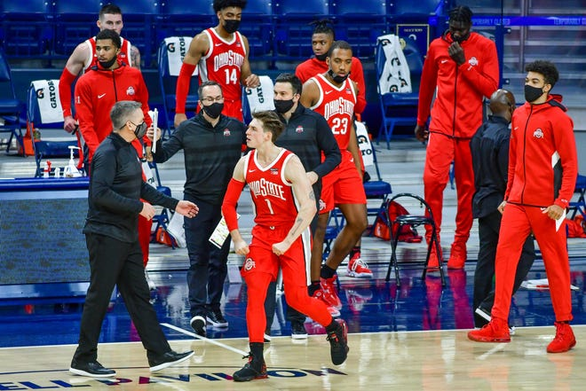 Dec 8, 2020; South Bend, Indiana, USA; Players on the Ohio State Buckeyes bench celebrate in the second half against the Notre Dame Fighting Irish at the Purcell Pavilion.