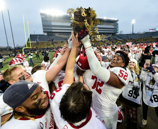 Indiana players celebrate with the Old Oaken Bucket after the Hoosiers' double-overtime win last Nov. 30.