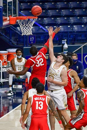 Dec 8, 2020; South Bend, Indiana, USA; Notre Dame Fighting Irish forward Matt Zona (25)  goes up for a shot as Ohio State Buckeyes forward E.J. Liddell (32) defends in the second half at the Purcell Pavilion.