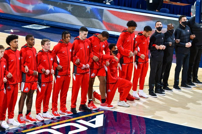 Ohio State forward Seth Towns takes a knee during the national anthem before Tuesday's men's basketball game at Notre Dame.