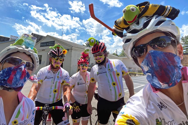 """Pan-Mass Challenge bike riders (from left) Cathy Ellis, Steven Branfman, Stephanie Vail, Jeremy Vail, and Celia Donatio pose for a selfie in Newton on July 31. """"Team Kermit"""" raised close to $554,000 for Dana Farber Cancer Research."""
