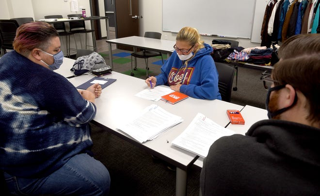 Excel Center SkillUp life coaches Melissa Williams, left, and Mathew Swan help enroll student Nancy Langley of Columbia in classes Wednesday at the Excel Center at 101 N. Fourth St. Classes will begin next month. The Goodwill Excel Centers — adult high schools — recently earned accreditation from the Missouri Nonpublic Schools Accrediting Association. Goodwill Excel Centers are operated by MERS Goodwill of Missouri.