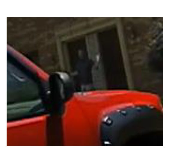 This still image, captured from a Columbus police officer's body camera, shows ATF agent James Burk outside a home in July. Burk says the officers used excessive force and unlawfully detained him for an hour while he was working.