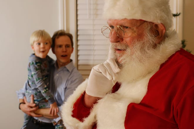 "Henry and his father are visited by Santa Claus in a scene from ""'Twas the Night Before Christmas,"" the first film from Columbus Children's Theatre."