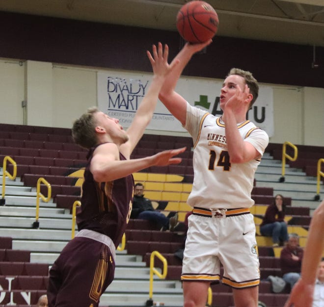Minnesota Crookston redshirt junior guard Brian Sitzmann shoots over a defender during a game against Minnesota Duluth on Feb. 21, 2020.