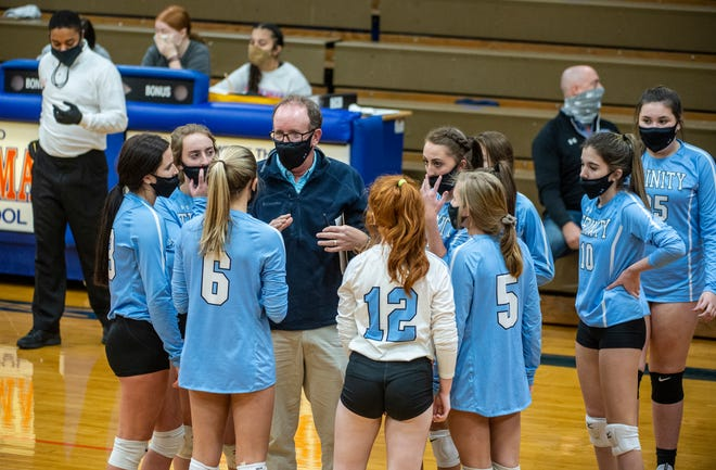 Trinity coach Rodney Kriby talks to his team during a timeout against Randleman in PAC-7 action at Randleman on Monday. (PJ Ward-Brown for The Courier-Tribune)