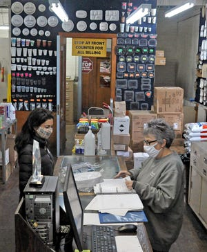 Customer Ramni Arora places her order with Yvonne Hendershott, a worker at Friendly Wholesale. The business has been in Wooster for 70 years.