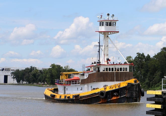 A boat travels through the Houma Navigation Canal.