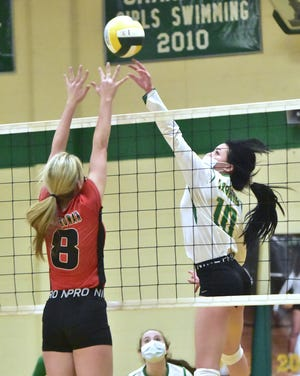 South Rowan's Kali Nelson goes up to try and block the shot from West Davidson's Kerryn Terry Tuesday night in Tyro. [David Yemm for The Dispatch]