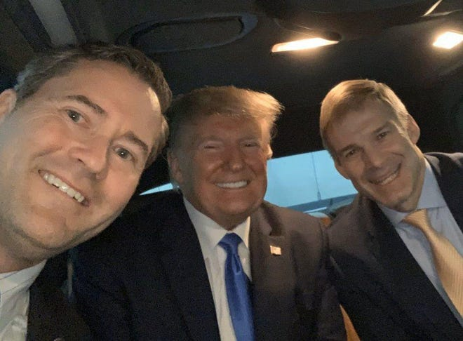 U.S. Rep. Michael Waltz, left, rides in a limo to a dinner in Miami on Dec. 7, 2019, with President Donald Trump and Rep. Jim Jordan of Ohio. Waltz is joining a lawsuit asking the Supreme Court to intervene in the 2020 election on Trump's behalf.