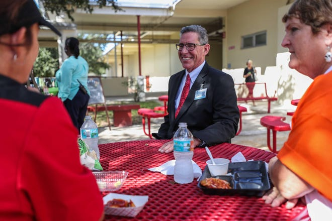 Tom Russell speaks with School Way Cafe workers as superintendent of the Volusia County school district.